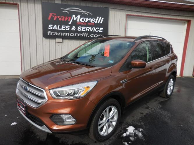 2017 Brown Ford Escape SE 4WD (1FMCU9GD8HU) with an 1.5L L4 DOHC 16V engine, 6A transmission, located at 8464 Route 219, Brockway, PA, 15824, (814) 265-1330, 41.226871, -78.780518 - Photo #0