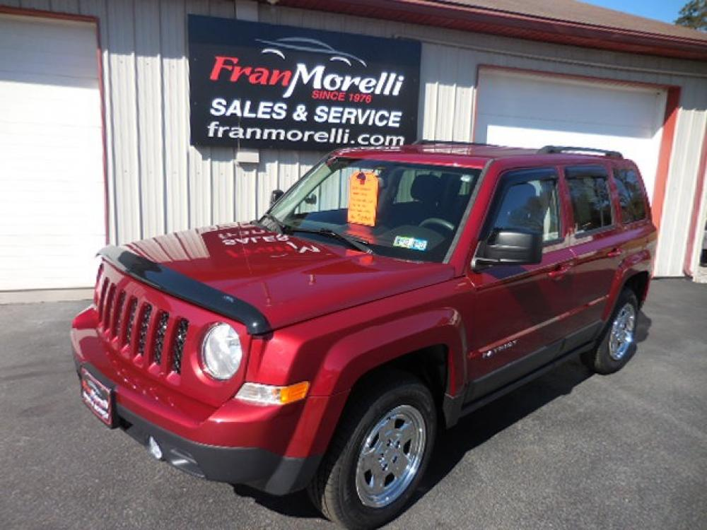 2016 Red Jeep Patriot Sport 4WD (1C4NJRBB9GD) with an 2.4L L4 DOHC 16V engine, AUTO transmission, located at 8464 Route 219, Brockway, PA, 15824, (814) 265-1330, 41.226871, -78.780518 - Photo #0