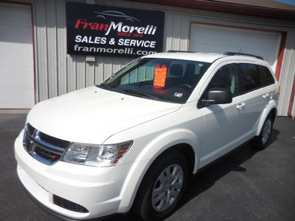2018 White Dodge Journey SE (3C4PDCAB7JT) with an 2.4L L4 DOHC 16V engine, 4A transmission, located at 8464 Route 219, Brockway, PA, 15824, (814) 265-1330, 41.226871, -78.780518 - Photo #0